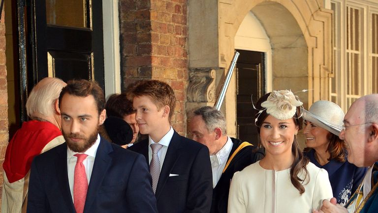 Hugh Grosvenor at an event behind Pippa and James Middleton