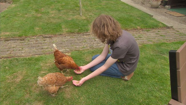 Asperger syndrome sufferer Josh Martin feeds the family's chickens