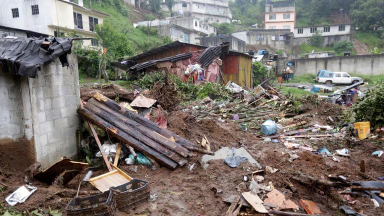 Houses in Huauchinango, Mexico, were damaged after Hurricane Earl caused heavy rain and mudslides