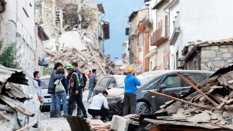 Residents stand in the street in Amatrice, northern Lazio