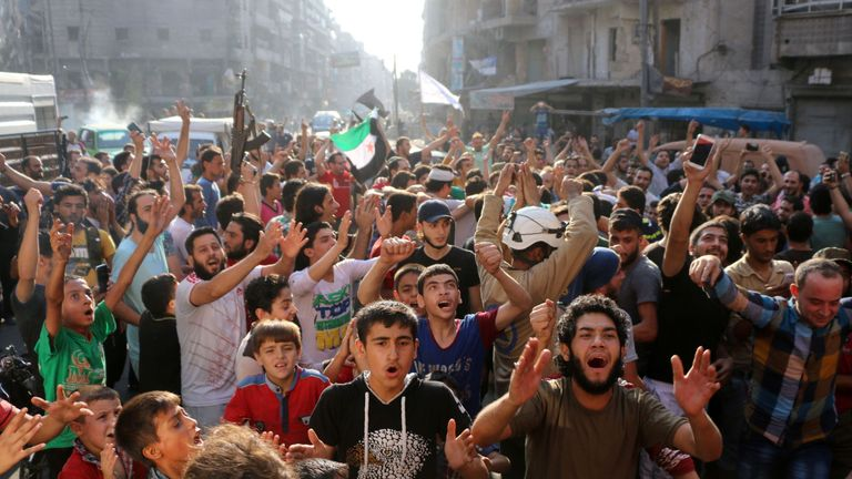 Syrians celebrate in Aleppo after rebels said they had broken a three-week government siege