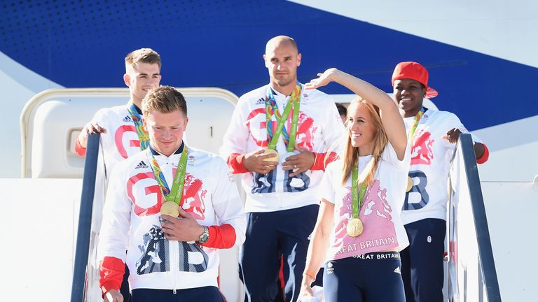 Team GB Swimmer and gold medallist Adam Peaty leaves the aeroplane with fellow gold medallist and rower Helen Glover