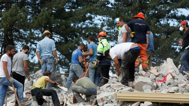 Rescuers continue to look for survivors in the devastated town of Amatrice