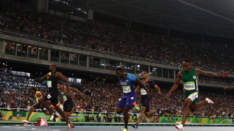Usain Bolt of Jamaica celebrates as he wins the 100m final