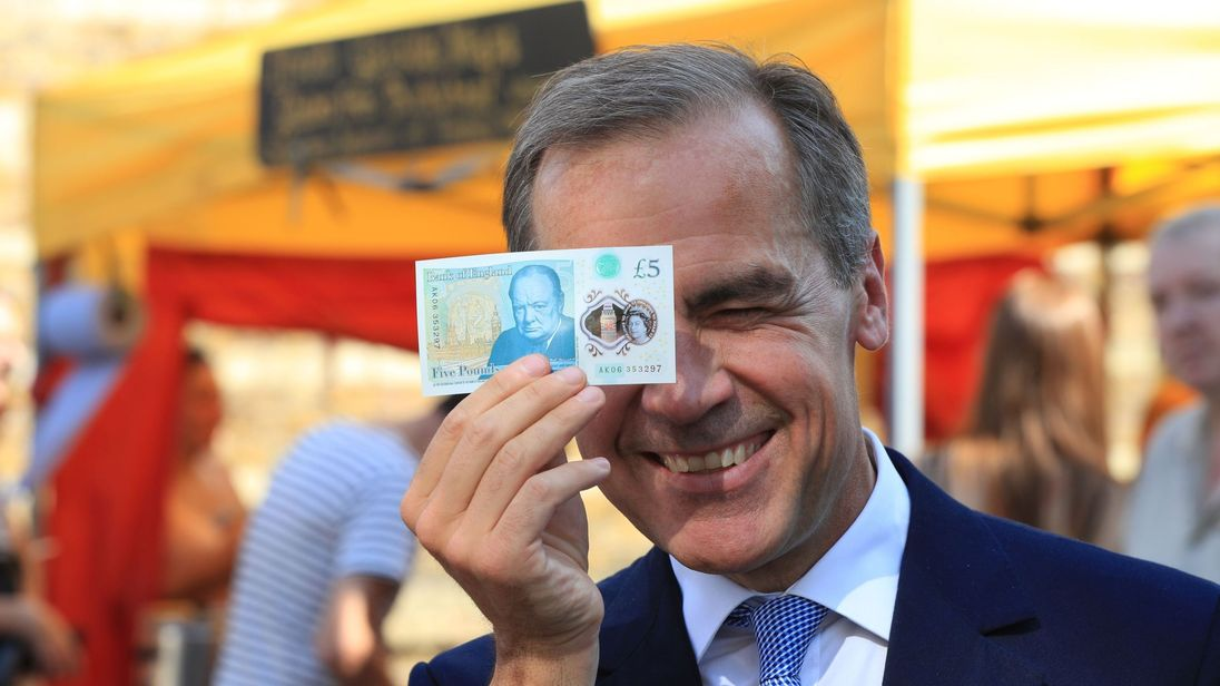 Bank of England governor Mark Carney with a new £5 note as London's Whitecross Street market