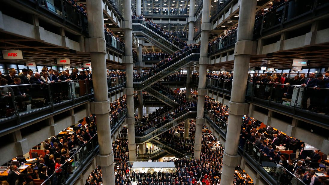 Staff at the annual Remembrance Day service at Lloyd's of London, 11 November 2015