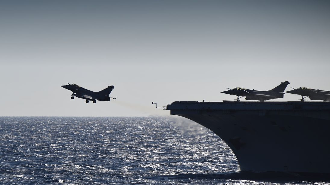A rafale fighter jet takes off from the French aircraft carrier Charles de Gaulle in the Mediterranean