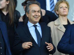 Everton's Iranian owner Farhad Moshiri (C) is happy with the start to the season