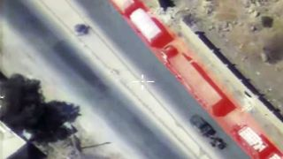 Image from Russian drone showing aid convoy and military vehicle