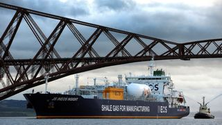 A bagpiper plays from the prow of the JS Ineon Insight ship carrying the first shipment of shale gas from the United States as it passes the Forth bridge to dock at Grangemouth in Scotland on September 27, 2016. The carrier, transporting 27,500 cubic metres of ethane, was given a traditional Scottish welcome, passing under the Forths iconic 19th century steel rail bridge as a lone bagpiper played from the ship. A £2 billion (2.3 billion euros, $2.6 billion) investment by Ineos, the world's third