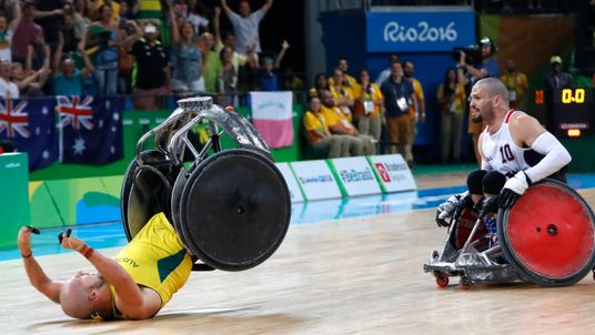 Josh Wheeler (R) of USA watches Ryley Batt of Australia celebrate winning gold medals after the Rio Paralympics Wheelchair Rugby final