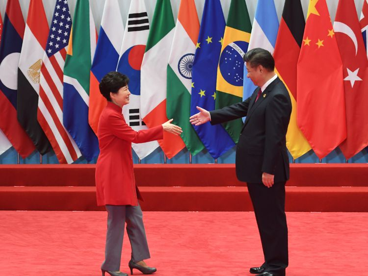 Park Geun-Hye (left) is greeted by Xi Jinping at the G20 summit