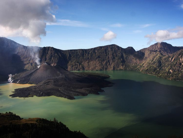 This file picture shows Mt Barujari surrounded by a lake in the caldera of Mt Rinjani