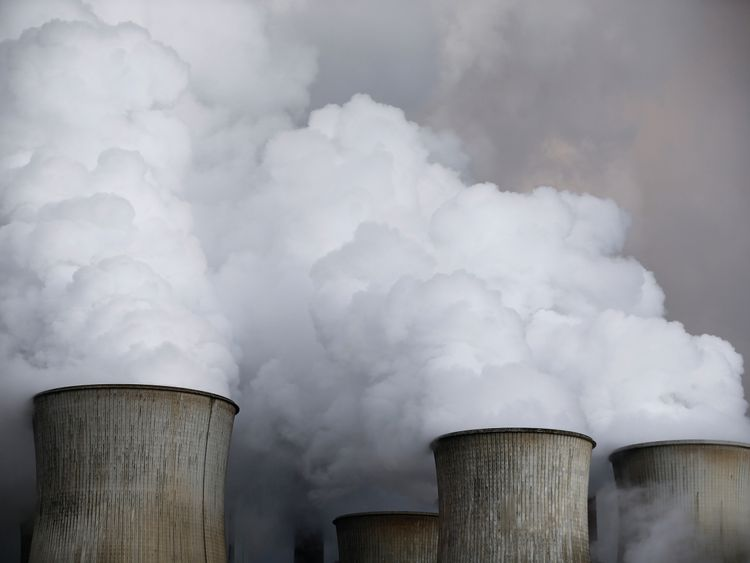 Steam rises from the cooling towers of the RWE coal power plant in Niederaussem, Germany