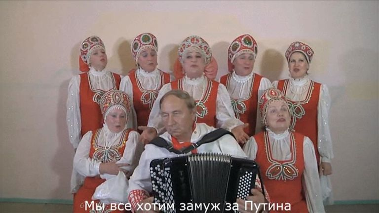 """A Russian blogger and musician has had a surprise internet hit after writing a song about a woman who is in love with Russian President Vladimir Putin and wants to marry him.  Oleg Lomovoy often writes and records satirical music videos and poems on topical Russian issues but until now has only been known to a small audience.  His latest video with a choir of Russian """"grannies"""" in national costumes has reached nearly 130-thousand views in just three days."""
