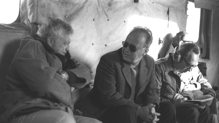 Then defence minister Shimon Peres sits on a military helicopter flight in 1975 with then Prime Minister Yitzhak Rabin and security adviser Ariel Sharon