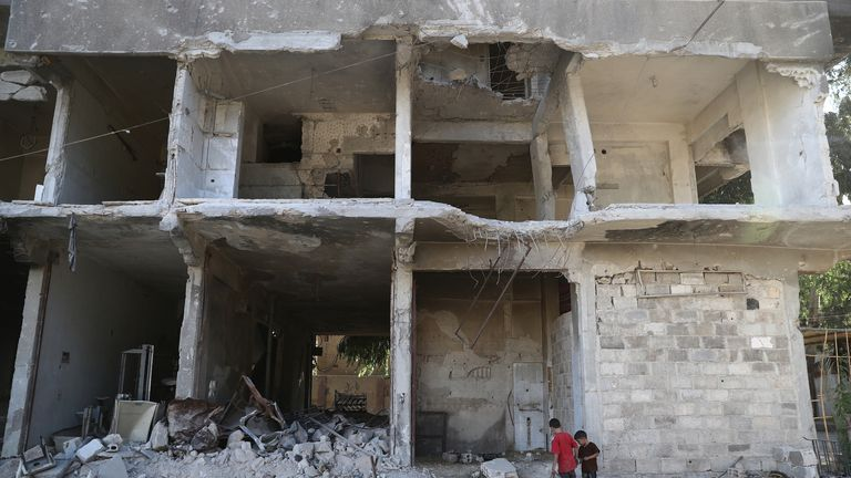 Syrian children in the rubble of a building in rebel-controlled Hamouria