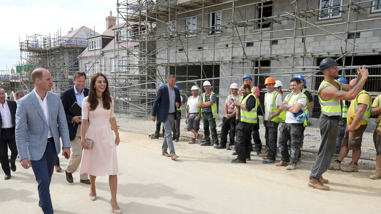 The Duchess of Cambridge shares a joke with a construction worker - who takes a selfie