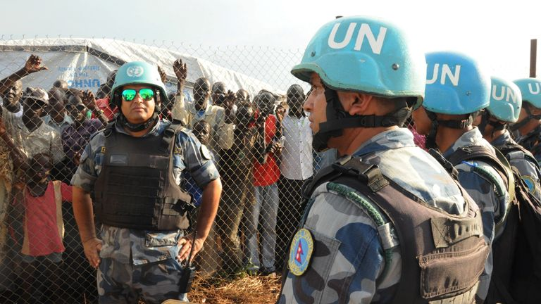 UN peacekeepers stand guard at a demonstration by people displaced by fighting near South Sudan's capital Juba