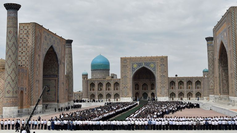 People attend a mourning ceremony in Registan Square, Samarkand