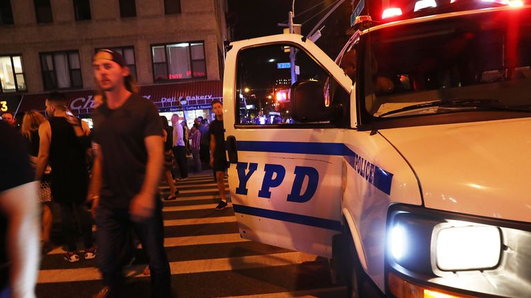 Police gather at the scene of an explosion in Manhattan