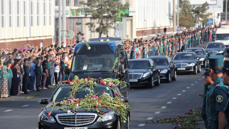 People lining the streets in Tashkent as the funeral cortege passes by