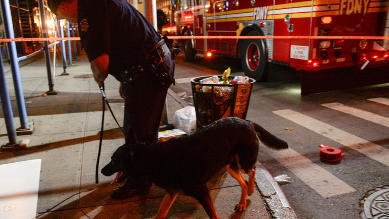 A NYPD officer with a police dog near the scene of the explosion