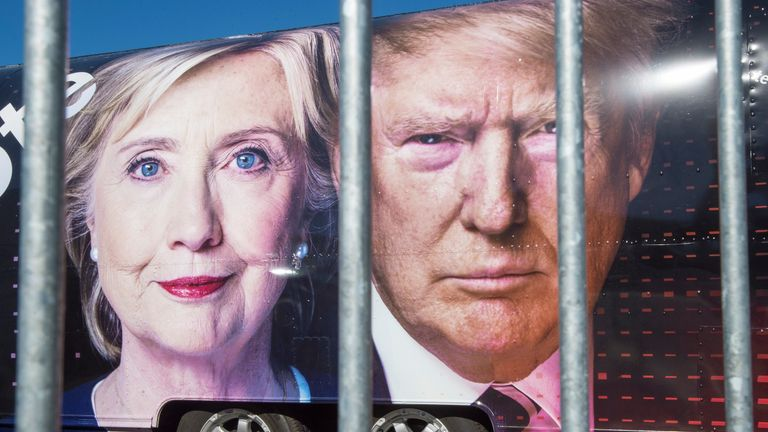 Pictures of Hillary Clinton and Donald Trump on the side of a campaign bus