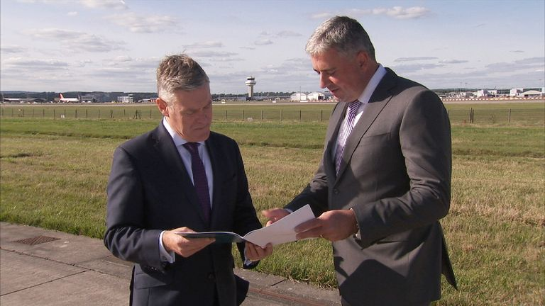 Gatwick's chief executive Stewart Wingate (r) gives Ian King a look at the airport's final submission for a new runway