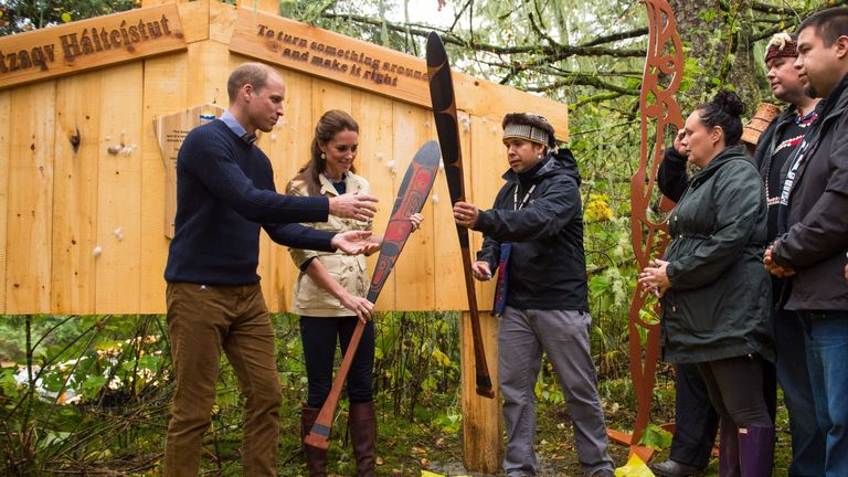 The Duke and Duchess of Cambridge are presented with canoe paddles as a gift from the Heiltsuk First Nation community during a visit to the Great Bear Rainforest in Bella Bella.