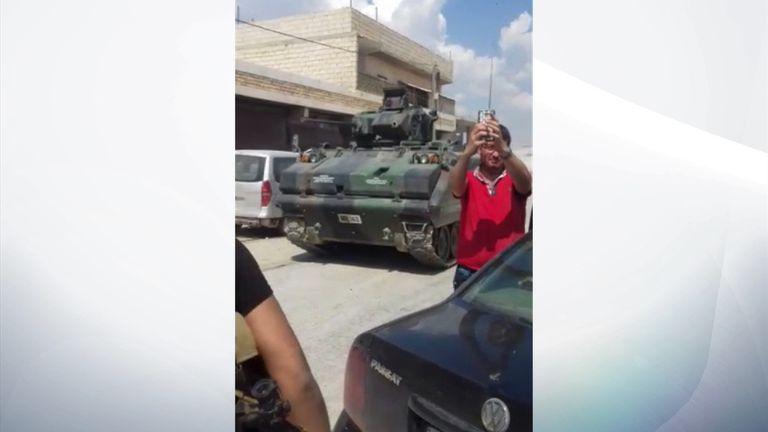 Turkish tanks entering the border town of Al-Rai