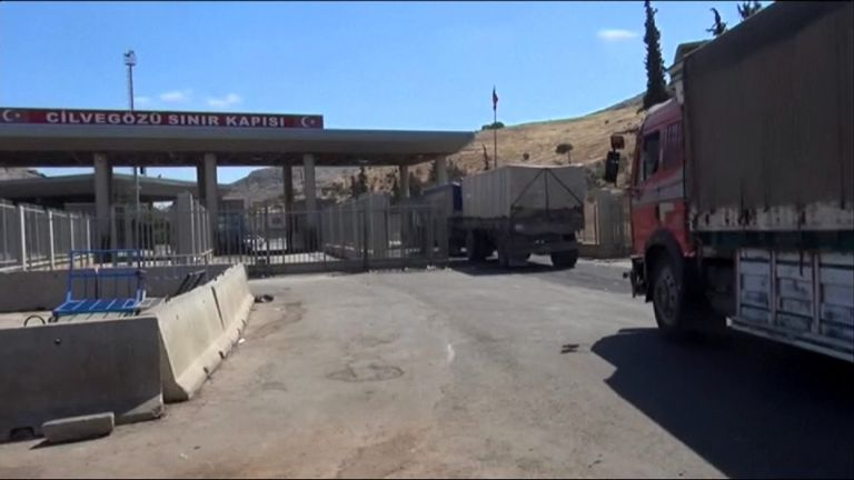 Aid trucks cross into Syria from the Turkish border town of Cilvegozu