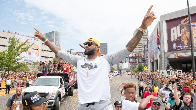 Ohio-based basketball star LeBron James celebrates in the streets of Cleveland