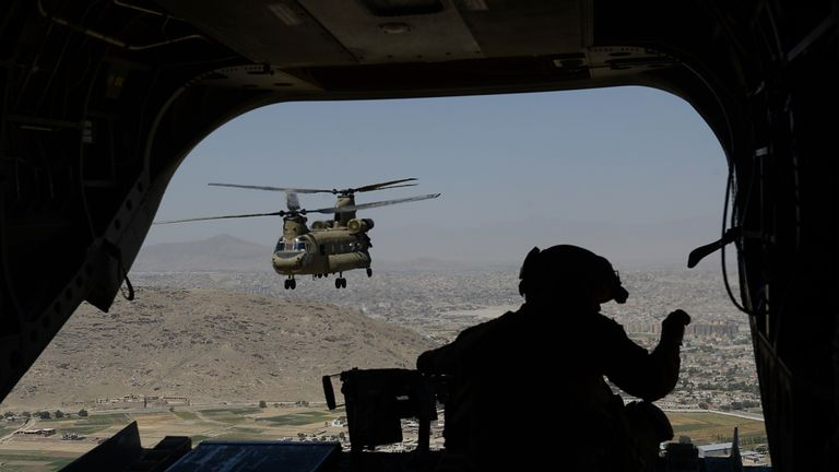 A US soldier aboard a Chinook helicopter in Afghanistan. File pic