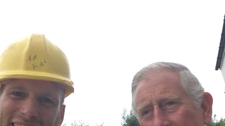 Scaffolder Sam Wayne snaps a selfie with Prince Charles at a housing development in Cornwall