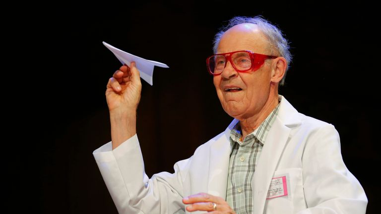 Chemist Dudley Herschbach, winner of the 1986 Nobel Prize for Chemistry, throws a paper airplane as part of the fun