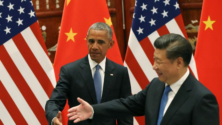 Barack Obama shakes hands with Xi Jinping after ratifying the Paris Agreement on climate change