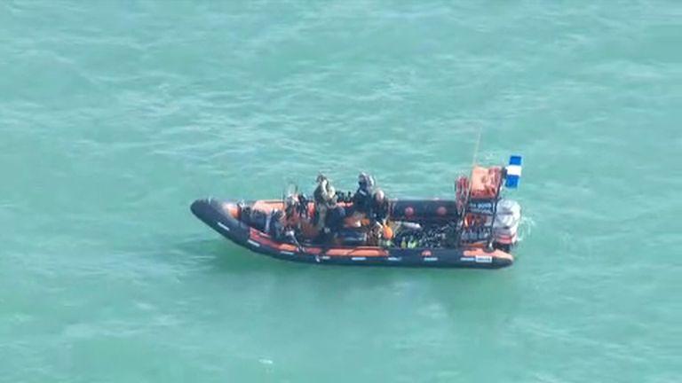 The Royal Navy bomb disposal team monitoring events