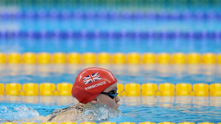 Ellie Simmonds set a new world record as she swam to her fifth Paralympics gold medal