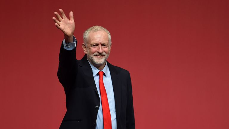 Jeremy Corbyn waves to supporters after his victory is confirmed