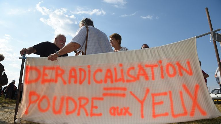 Locals protest the opening of the Pontourny centre, France's first deradicalisation centre, in Beaumont-en-Veron