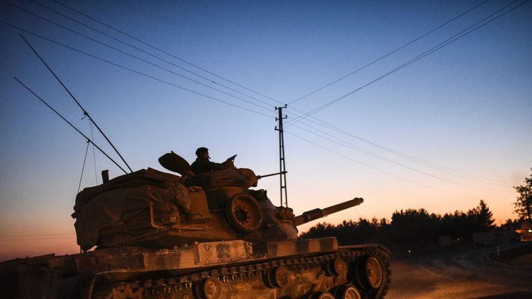 A Turkish army tank driving back from the Syrian-Turkish border town of Jarabulus