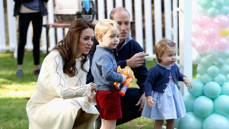 The Duke and Duchess of Cambridge with their children at a kid's party