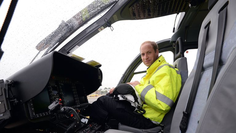The Duke of Cambridge sits in the cockpit of an air ambulance helicopter