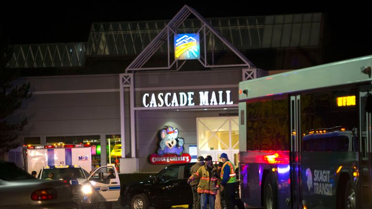 Police attend the Cascade Mall after four women were shot dead