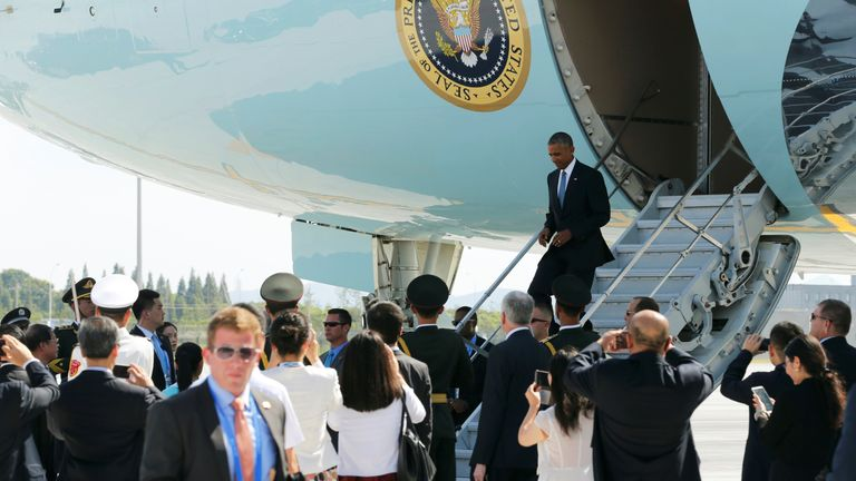 Barack Obama disembarks from Air Force One in China for the G20 summit