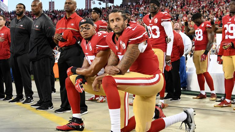 Colin Kaepernick #7 and Eric Reid #35 kneel during the Star Spangled Banner ahead of the win over the Rams