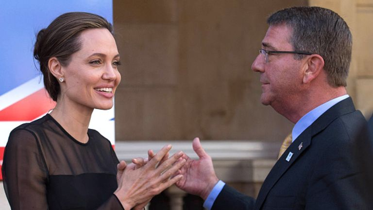 ngelina Jolie speaks to US Defence Secretary Ash Carter at the conference