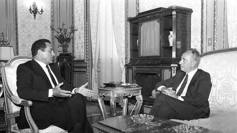 Shimon Peres, as Prime Minister of Israel, discusses affairs with Egypt's then President Hosni Mubarak after an agreement about the Taba border