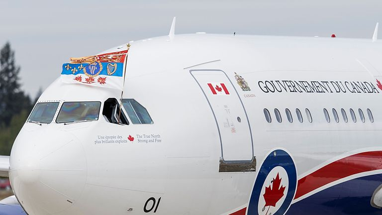 The Duke of Cambridge's flag flies out of the pilot's window of the plane carrying the Royals